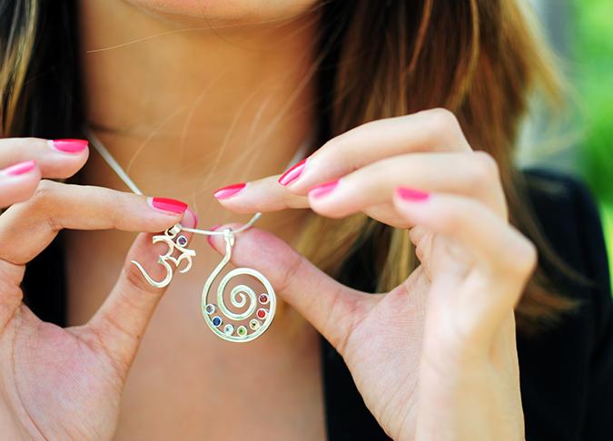Basic Vibes | Akanksha Redhu | holding both pendants in fingers equally