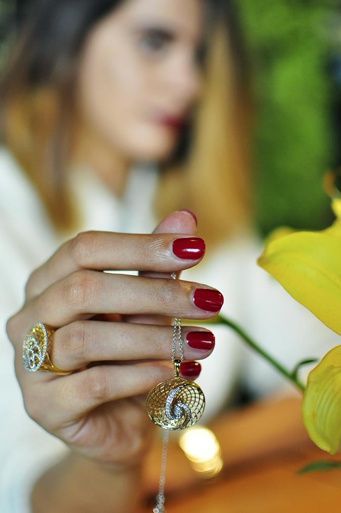 BeeJewelled - CaratLane | Akanksha Redhu | holding pendant with flower