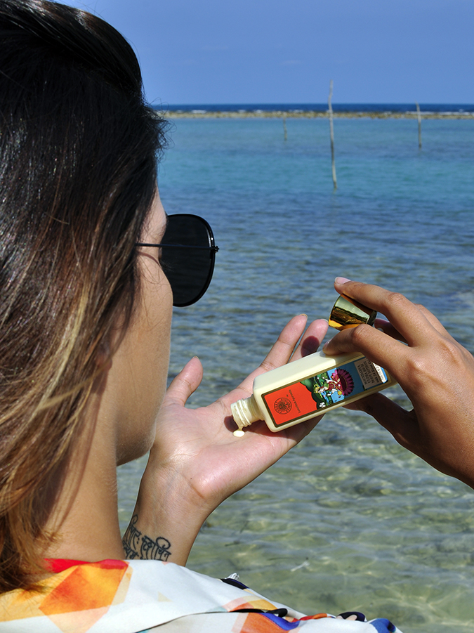 Koh Samui   Akanksha Redhu   pouring lotion in hand