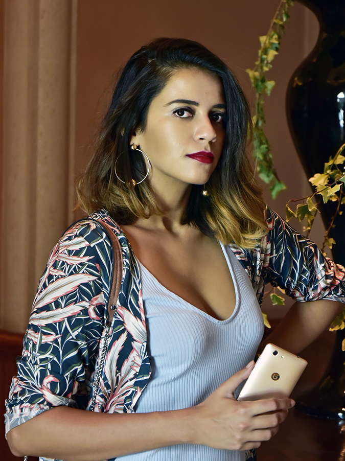 Gionee F103 Pro | Akanksha Redhu | half front holding phone arm on waist