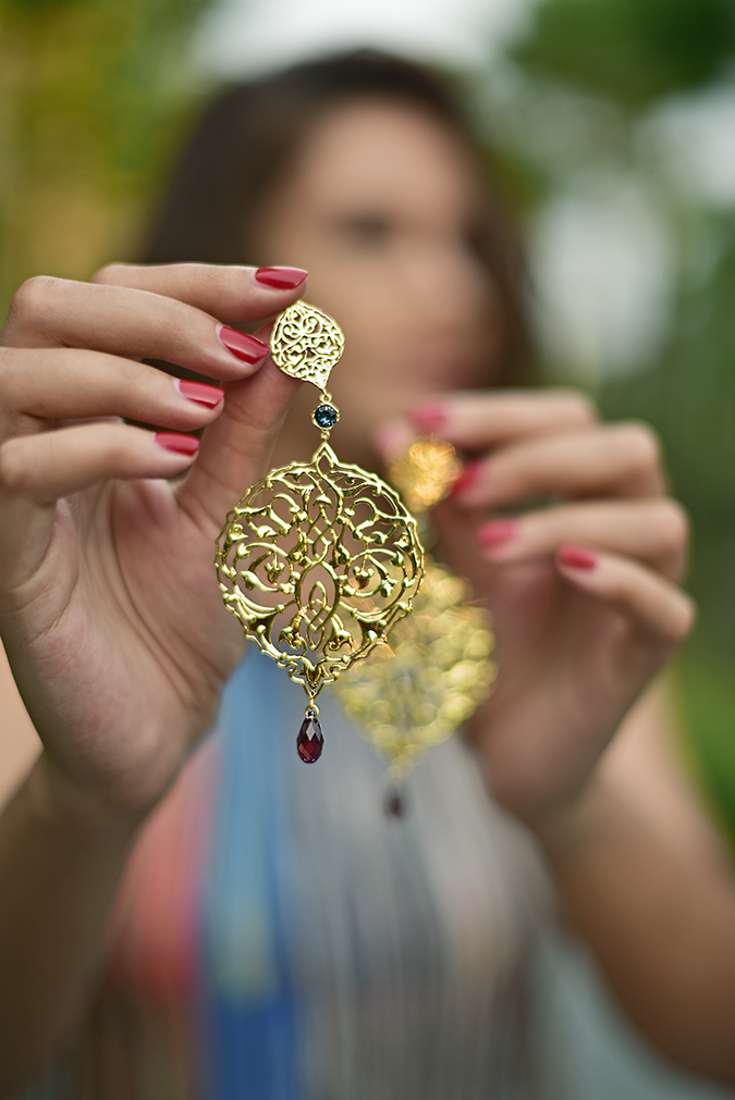 Swarovski Confluence | Akanksha Redhu | earrings hanging in hand