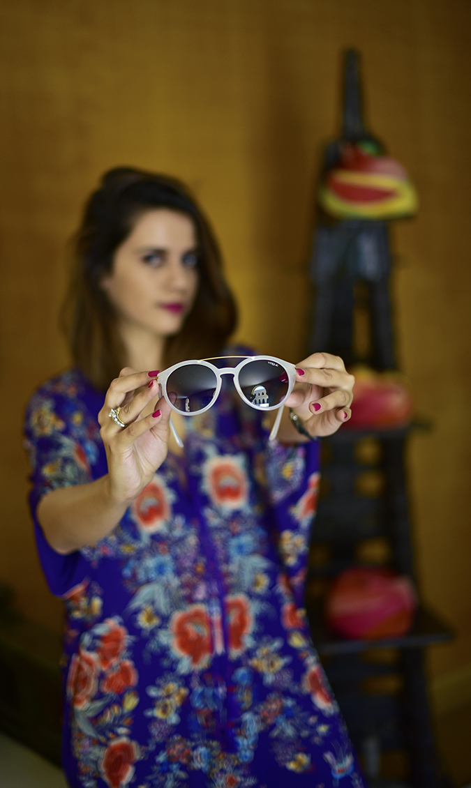 #ShowYourVogue | Akanksha Redhu | half front holding out sunnies focus indoors