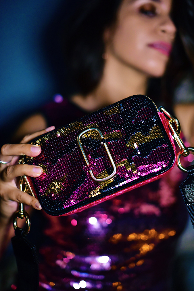 Akanksha Redhu | NYE | bag closeup face blurred