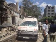 Ambulance visible damaged next to rubble in Shuyaiya neighborhood after Israel shelling, at Gaza, Palestine July 20 2014