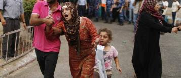 Distress Palestinian women running for safety after Israel bombarded Alshojaeya killing 64 July 19 2014