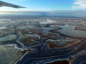 frozen river as seen from an airplane