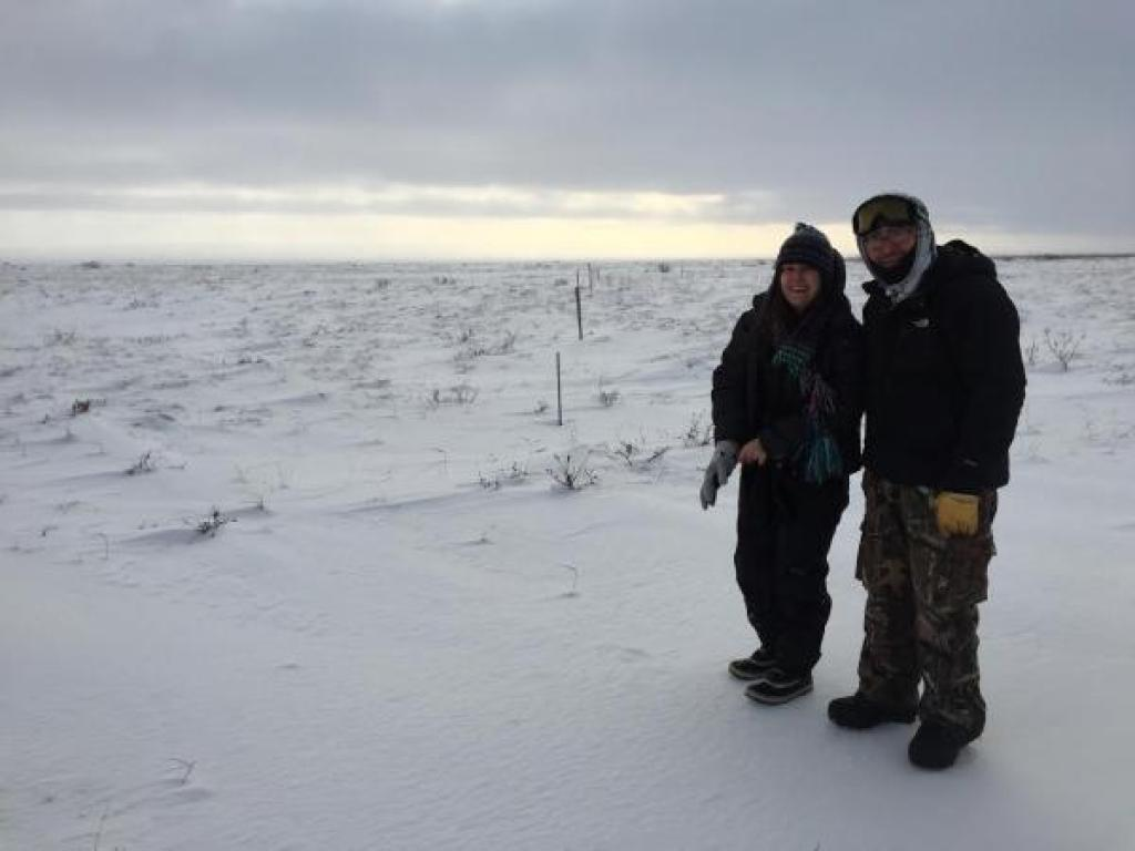 people in snowy field