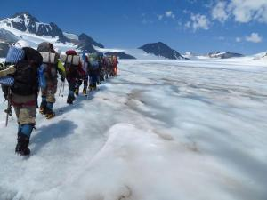group walking on a glacier
