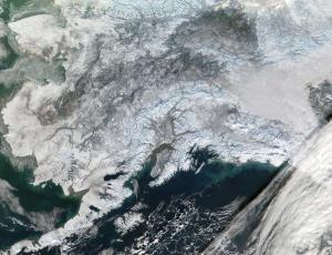 Image of a snow-covered Alaska taken by satellite during a cloudless day.