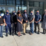 members of USCG MER and IARC posed for a photo in masks
