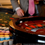Roulette games at A K Casino Knights man in pink wedding tie