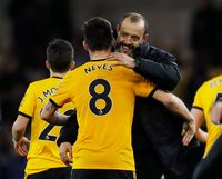 Soccer Football - FA Cup Third Round - Wolverhampton Wanderers v Liverpool - Molineux Stadium, Wolverhampton, Britain - January 7, 2019  Wolverhampton Wanderers manager Nuno Espirito Santo and Wolverhampton Wanderers' Ruben Neves celebrate after the match        REUTERS/Darren Staples