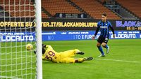 MILAN, ITALY - NOVEMBER 22: Lautaro Martinez of Inter Milan scores their sides fourth goal past Salvatore Sirigu of Torino during the Serie A match between FC Internazionale and Torino FC at Stadio Giuseppe Meazza on November 22, 2020 in Milan, Italy. Sporting stadiums around Italy remain under strict restrictions due to the Coronavirus Pandemic as Government social distancing laws prohibit fans inside venues resulting in games being played behind closed doors. (Photo by Valerio Pennicino/Getty Images)