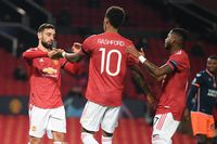 MANCHESTER, ENGLAND - NOVEMBER 24: Marcus Rashford of Manchester United celebrates after scoring their sides third goal with Bruno Fernandes (L)  and Fred (R) during the UEFA Champions League Group H stage match between Manchester United and İstanbul Basaksehir at Old Trafford on November 24, 2020 in Manchester, England. Sporting stadiums around the UK remain under strict restrictions due to the Coronavirus Pandemic as Government social distancing laws prohibit fans inside venues resulting in games being played behind closed doors. (Photo by Michael Regan/Getty Images)