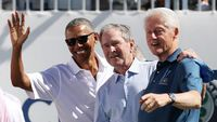 JERSEY CITY, NJ - SEPTEMBER 28: (L-R) Former U.S. Presidents Barack Obama, George W. Bush and Bill Clinton attend the trophy presentation prior to Thursday foursome matches of the Presidents Cup at Liberty National Golf Club on September 28, 2017 in Jersey City, New Jersey.   Rob Carr/Getty Images/AFP