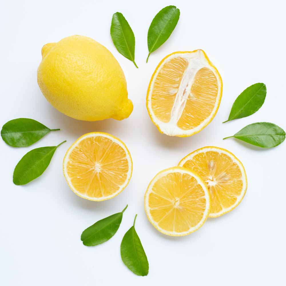Lemon fruit and leaves with slices