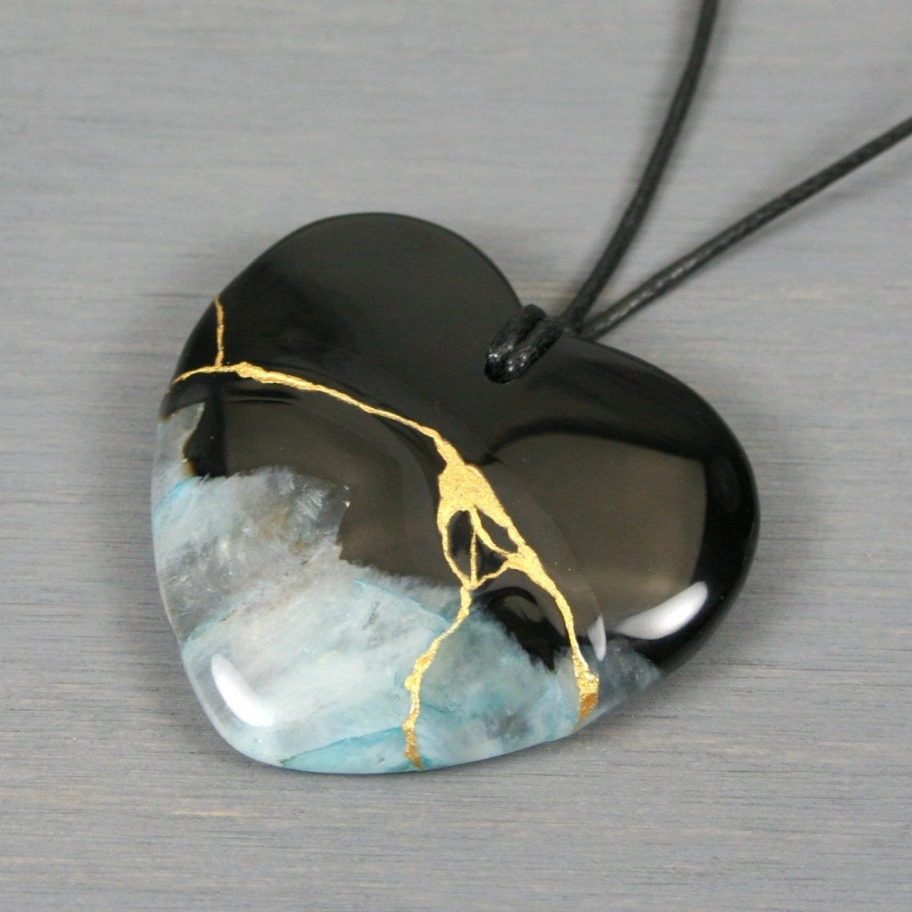 Black and blue druzy agate broken heart pendant with kintsugi repair on black cotton cord