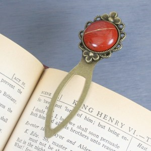 Red jasper with kintsugi repair on an antiqued brass bookmark