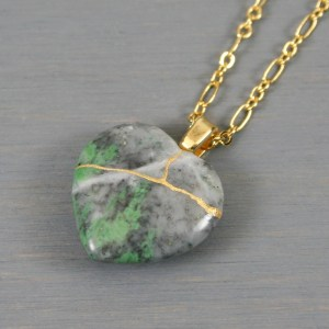 Green and gray stone broken heart pendant with kintsugi repair on chain necklace