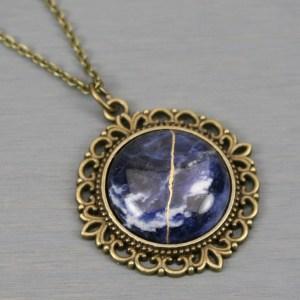 Sodalite kintsugi pendant in antiqued brass setting on chain