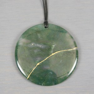 Large moss agate round pendant with kintsugi repair on black cotton cord