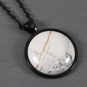 White howlite kintsugi pendant in black setting on chain