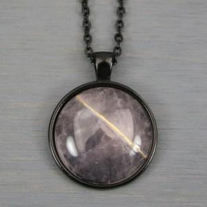 Rose quartz kintsugi pendant in black setting on chain