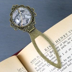 Black lace agate with kintsugi repair on an antiqued brass bookmark