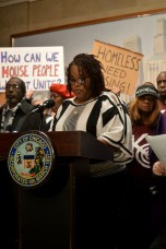 Cheryl Johnson, lifelong Altgeld Gardens resident speaks at the press conference at City Hall (Maya Dukmasova)