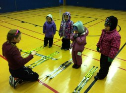 Showing the pre-K kiddies how to put on/take off their skis