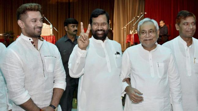 Ar With Union Minister Ram Vilas Paswan And Mp Chirag During The Swearing In Ceremony Of Ministers Bihar Cabinet 2017 Photo Pti
