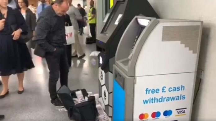 Bitcoin machine spits money in the middle of busy London station