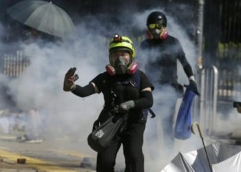 Fresh clashes erupt in Hong Kong college; police fire tear fuel, protesters hurl petrol bomb