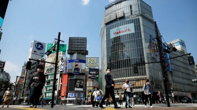 Japan's coronavirus emergency: Trains full on day one, but some shops shut