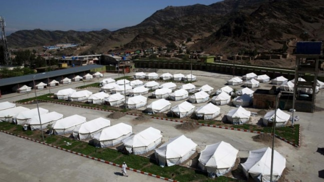 Untested for Covid-19, Afghans flee home from Iran's infection hot zone
