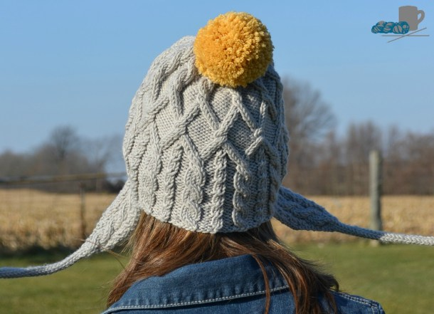 Merry cabled hat pattern with pompoms. www.aknitica.com #knitting #cables #pompoms