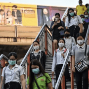 people walking down with wearing masks