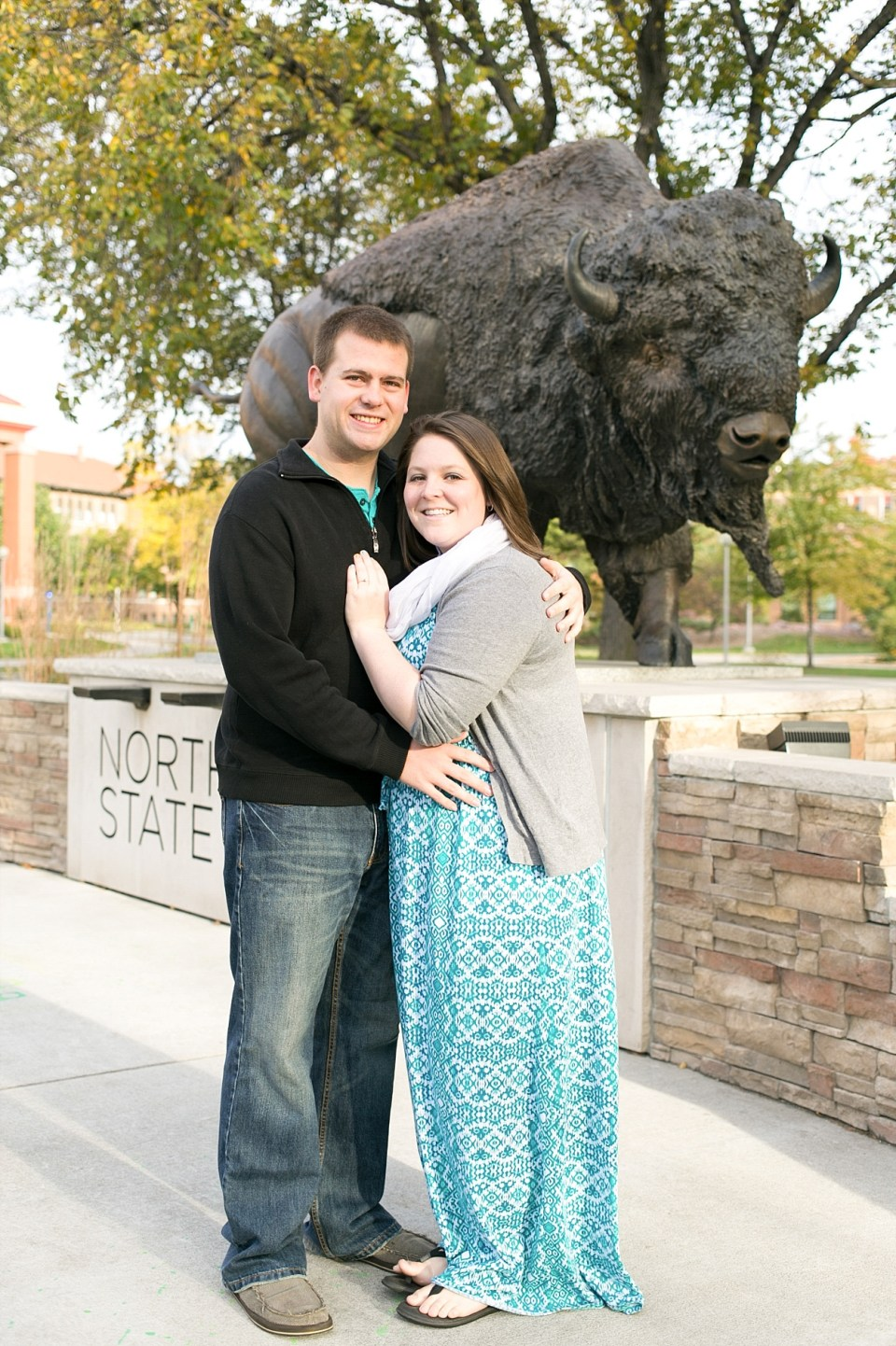 NDSU Engagement session in front of the NDSU Bison Bull