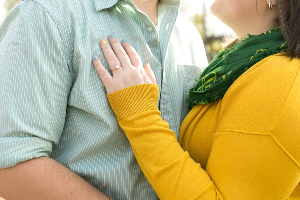 A couple shows off the engagement ring in yellow sweater and NDSU Bison scarf