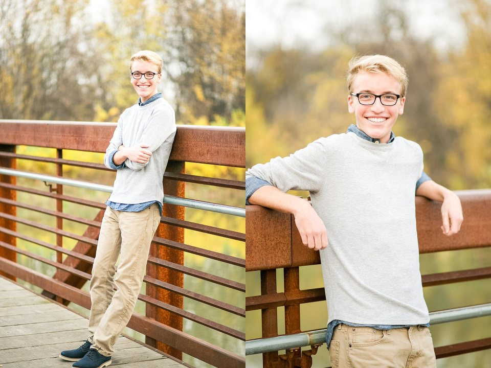 High School Senior leans against the Lindenwood Bridge over Fargo's Red River