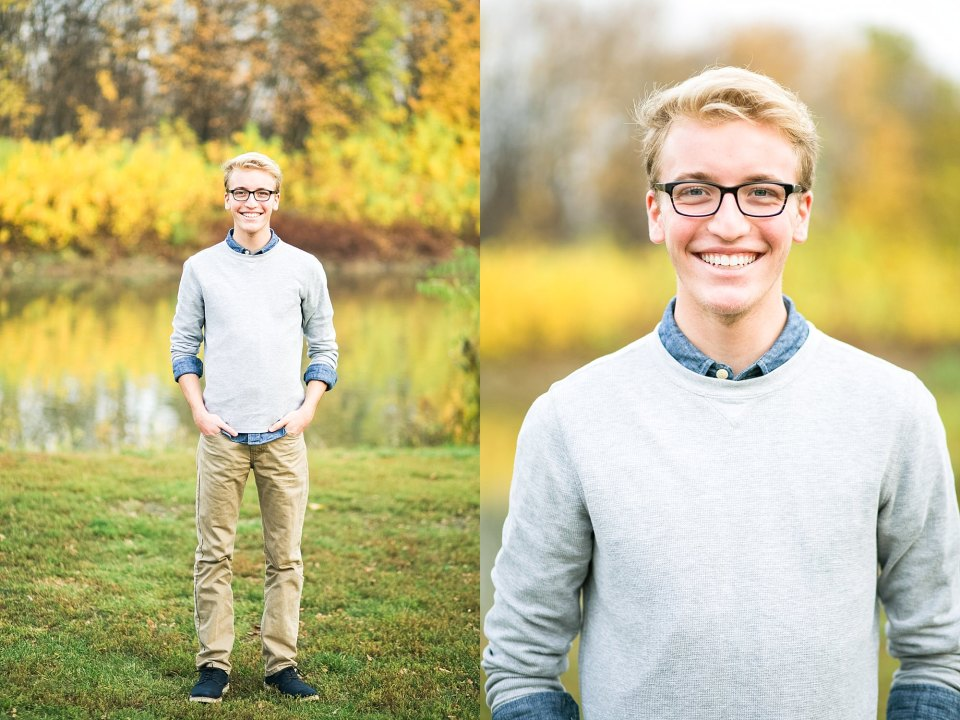 West Fargo, ND Senior in grey sweater and blue collared shirt along the Red River