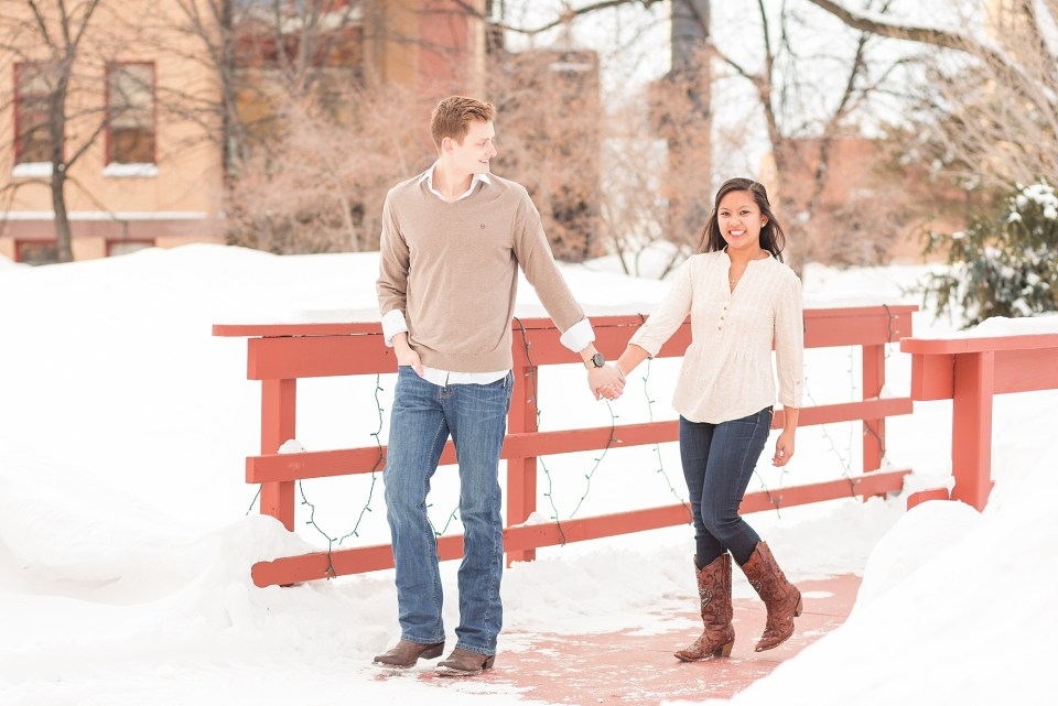 NDSU Engagement session on the snowy walking bridge