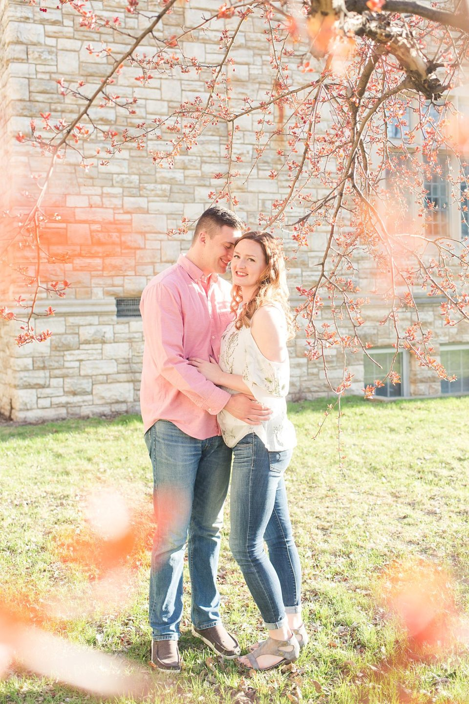 Spring Engagement Session in Shades of Pink Surrounded by Spring Blooms