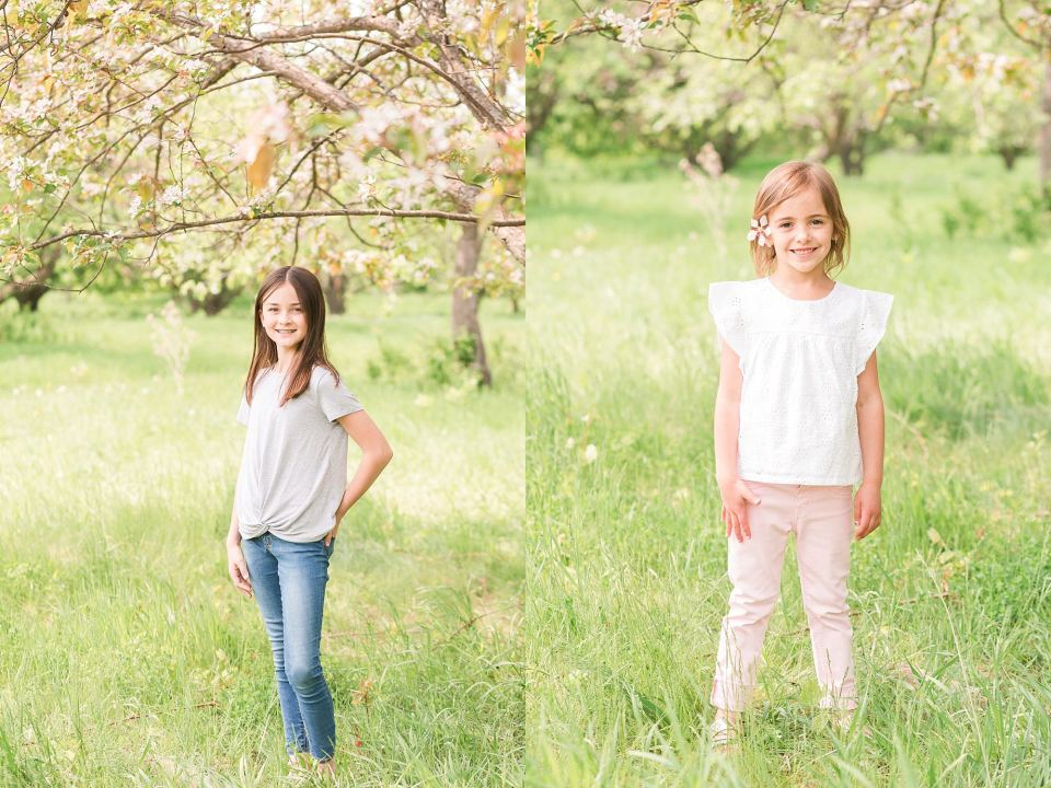 Two girls pose in grey and pink for spring photos