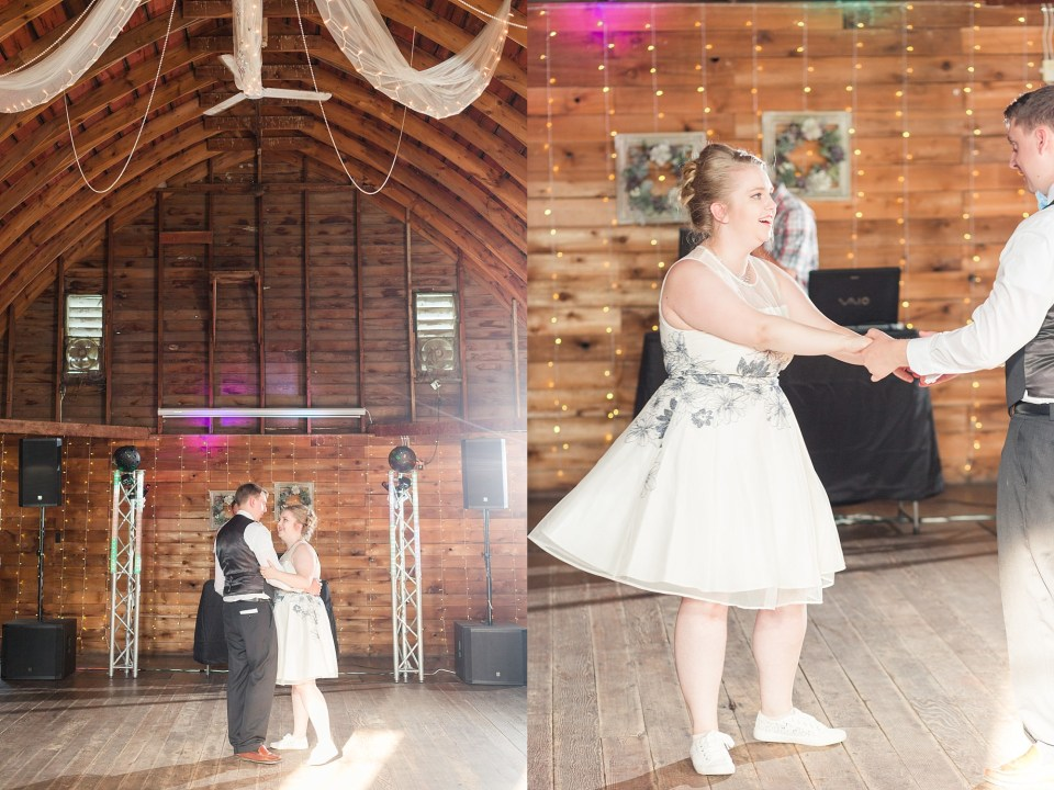 The bride, in her second dress, enjoys her first dance with her husband in the barn