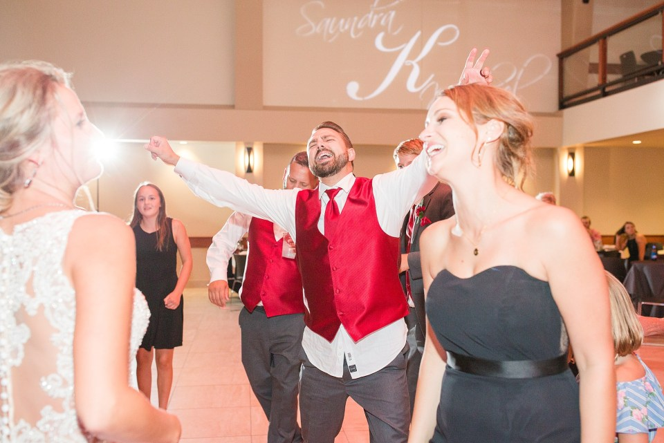 Guests dance the night away at this red and black Glamorous Wedding at the Avalon