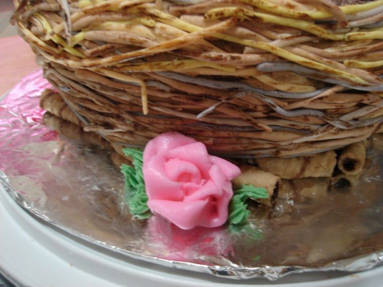 The bottom of the cake I placed some chocolate filled cookies that kind of looked like twigs.