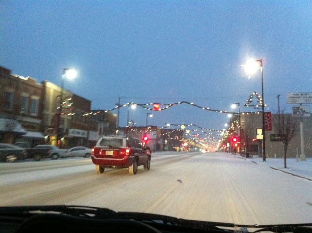 Downtown Pittsburg with a light snow on Friday evening