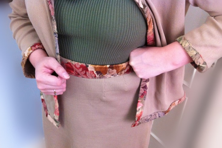 Contrasting trim on jacket and waistband