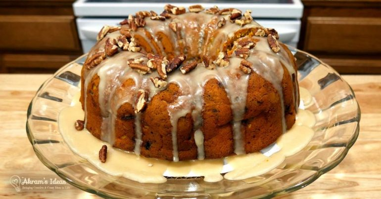 Indulge in the rich taste of fall with this recipe for Cranberry Apple Pumpkin Pecan Cake topped with Maple Frosting.